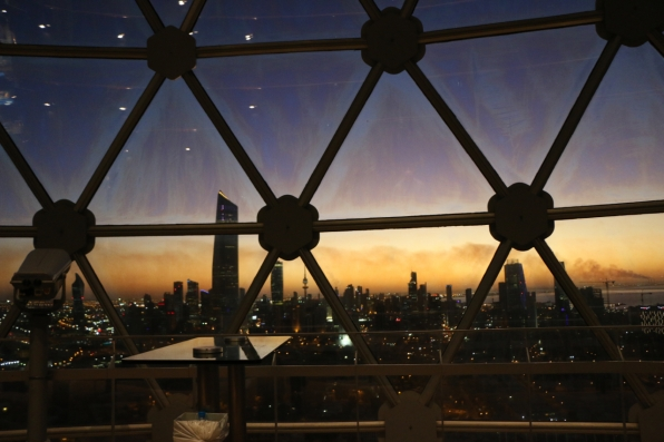 inside kuwait tower oil burning horizon sunset