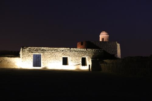 church lit up at night manama bahrain