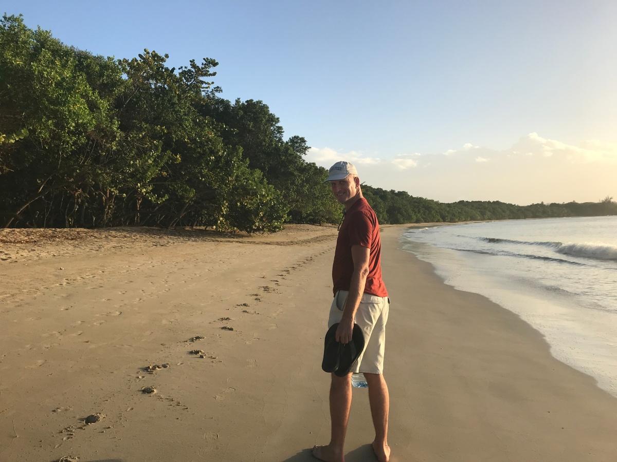 Chris walking beach Tobago horse tracks