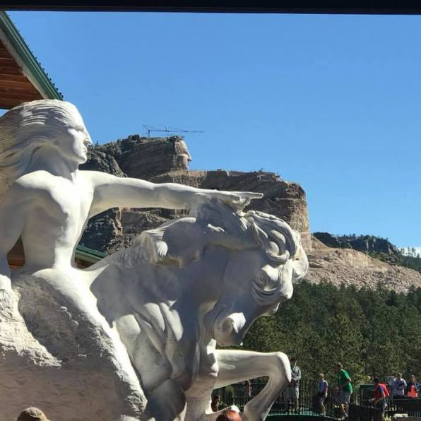 model and actual carving of Crazy Horse Memorial