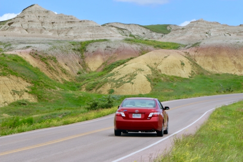 red car driving at Badlands National Park