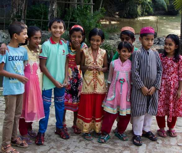 Bangladeshi children in colorful clothing standing