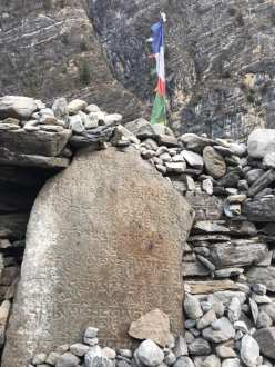 Buddhist texts on a rock outside of town