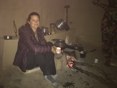 Woman sitting in mud hut drinking tea Rishikesh India