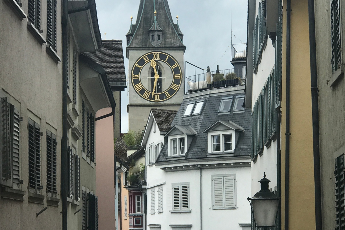 clock tower tall pointy church zurich switzerland