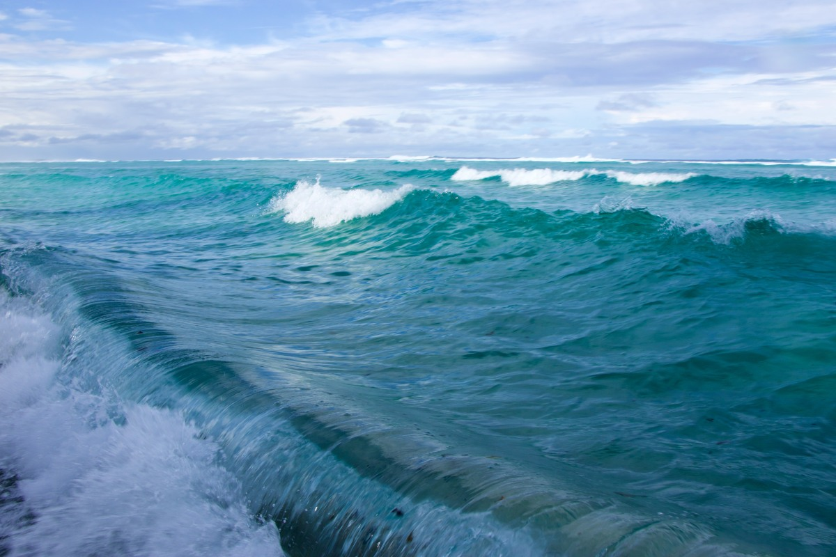 Blue Pacific Ocean waves crashing near Abaiang Island Kiribati