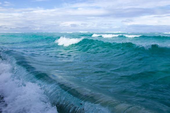 Blue Pacific Ocean waves crashing near Abaiang Island Kiribati